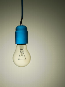 Incandescent light bulb with in-camera colour effect. Looks poor and rundown, bedsit